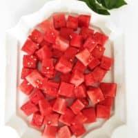 chunks of watermelon on large white platter