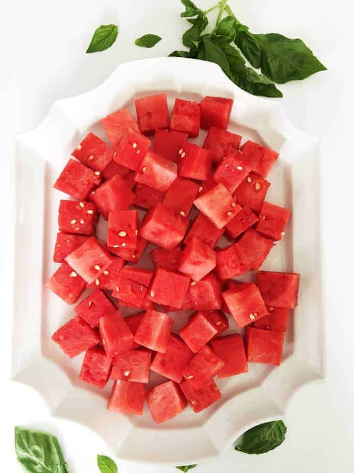chunks of watermelon on large white platter