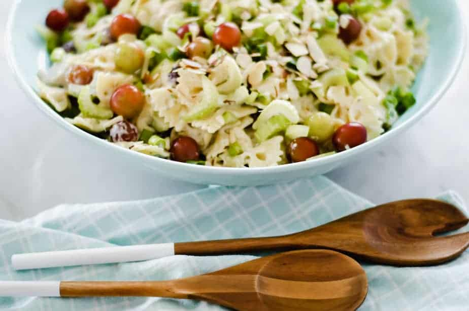 Bow tie pasta salad tossed with lemon, tarragon dressing, grapes, chicken, almonds, celery and green onion.