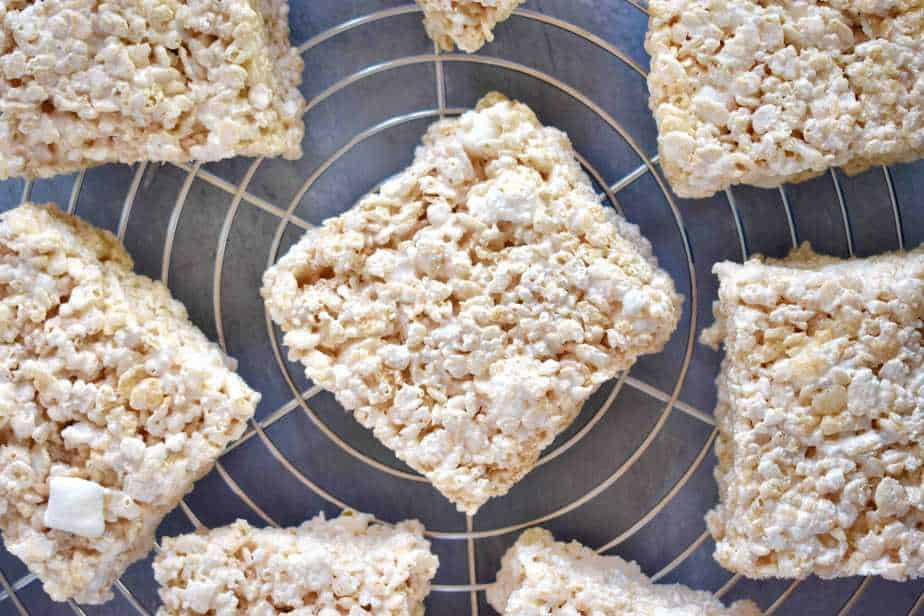 rice krispie treats spread out on cooling rack