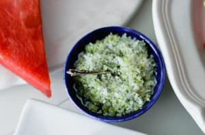 Lime-Mint salt in a small dish with watermelon slices
