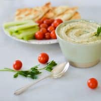 white bean hummus with pita and vegetables.