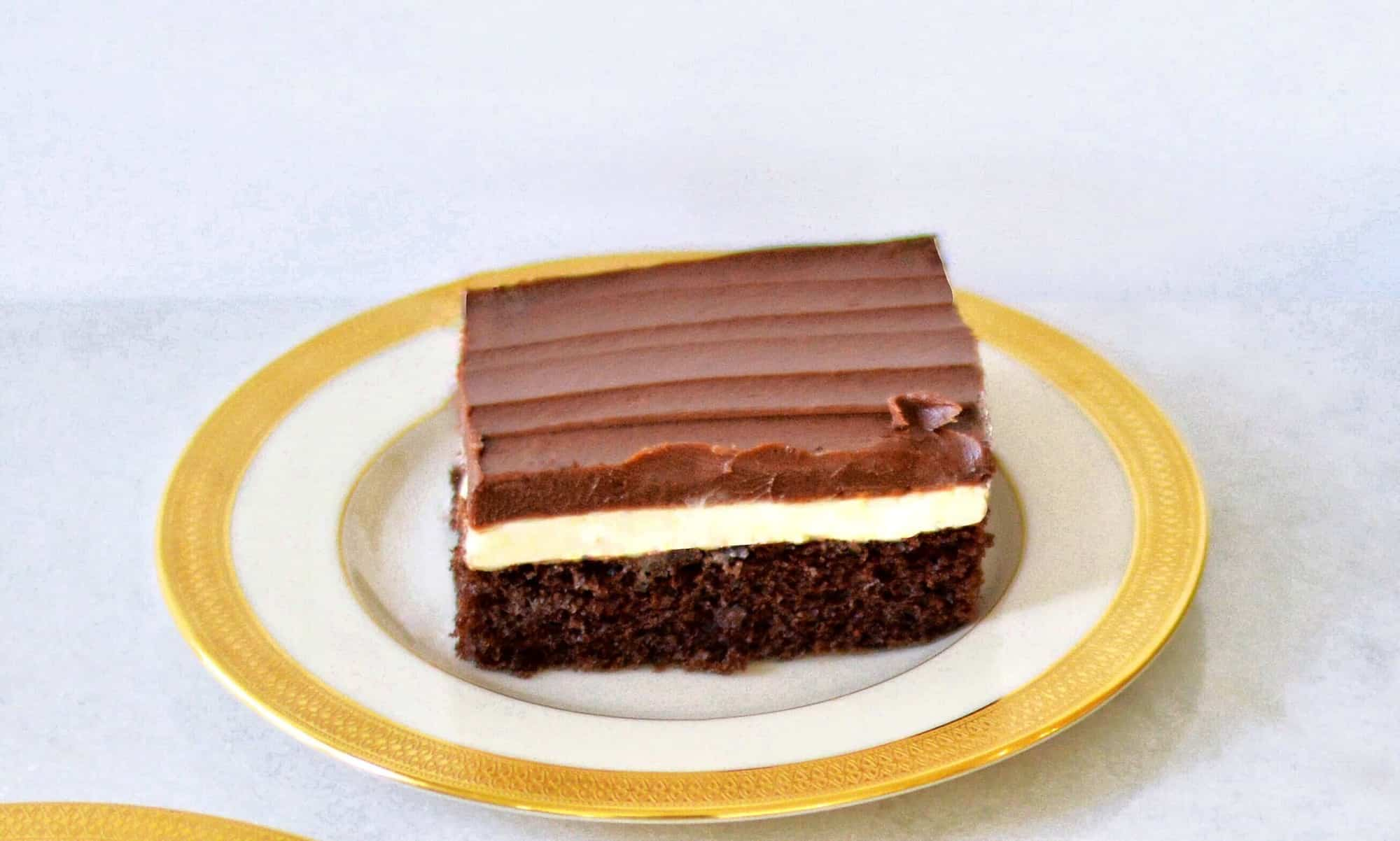 slice of Ho Ho cake: chocolate cake with layer of cream and ganache