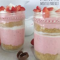 Strawberry Mousse Cheesecake Parfaits layered in small canning jars