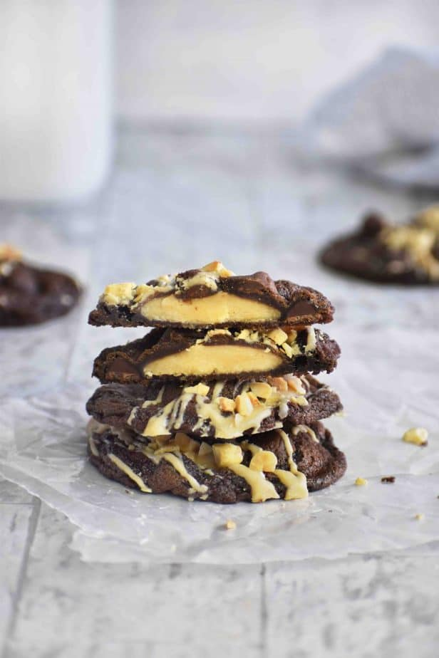 peanut butter cup cookies cut in half stacked on two whole cookies