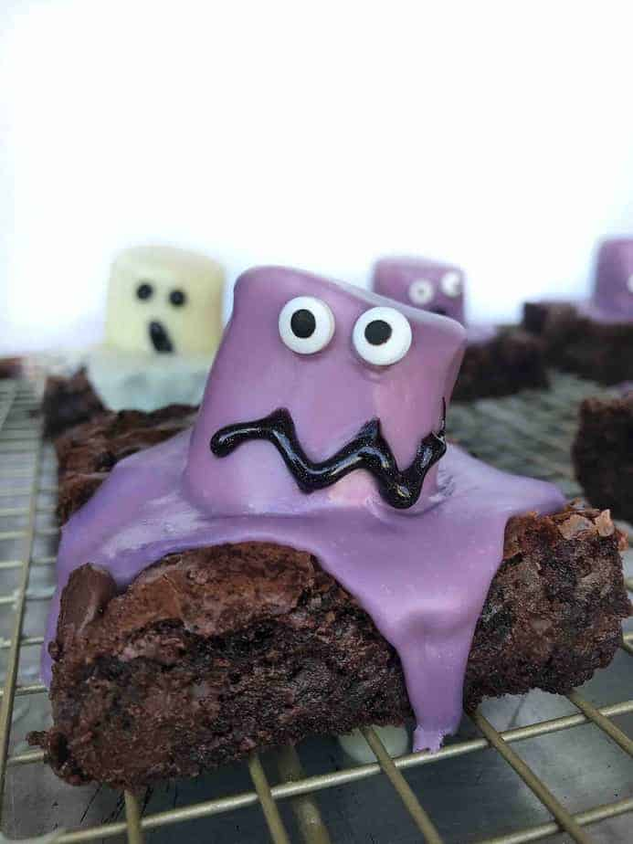 purple marshmallow monster brownie on cooling rack