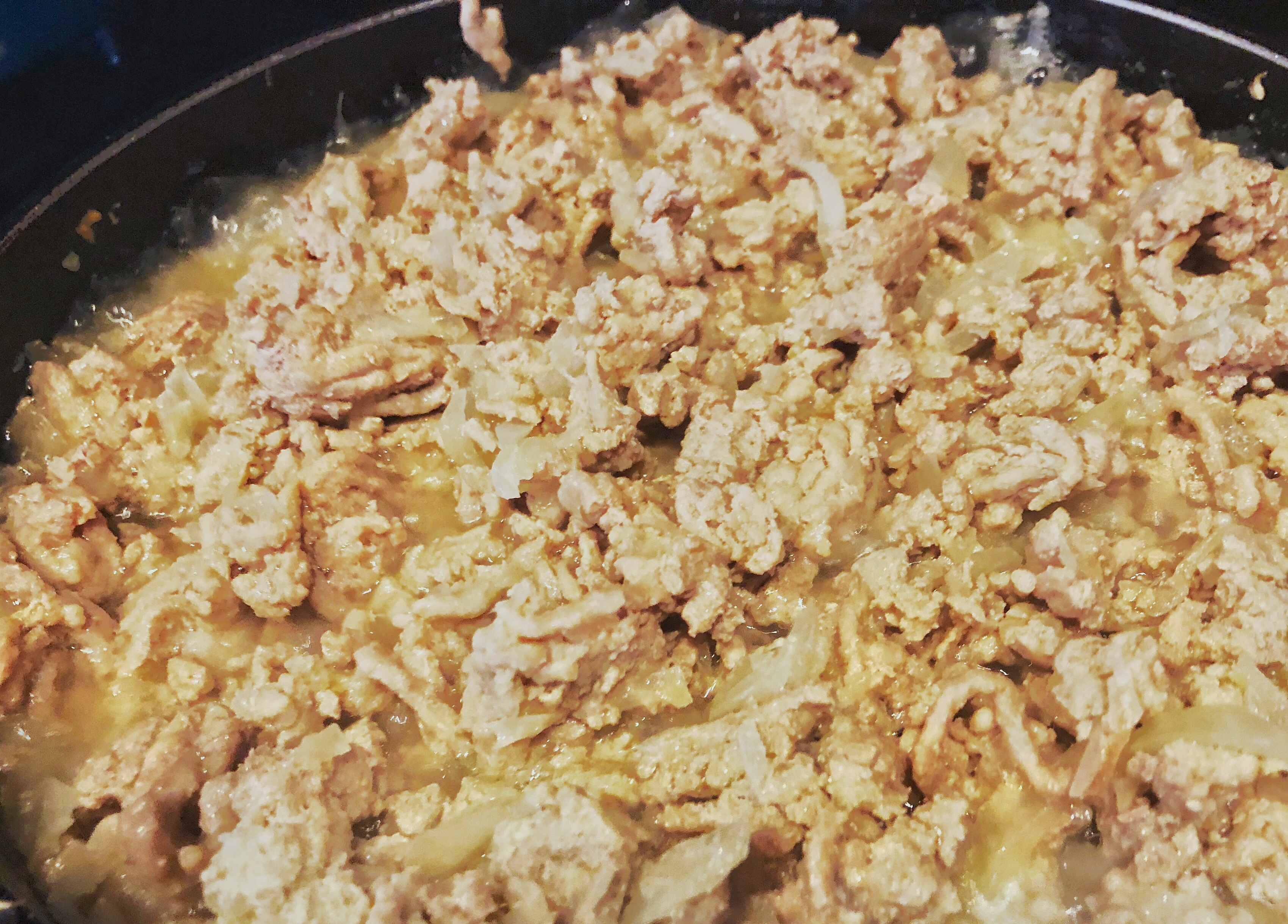 ground turkey cooking in saute pan