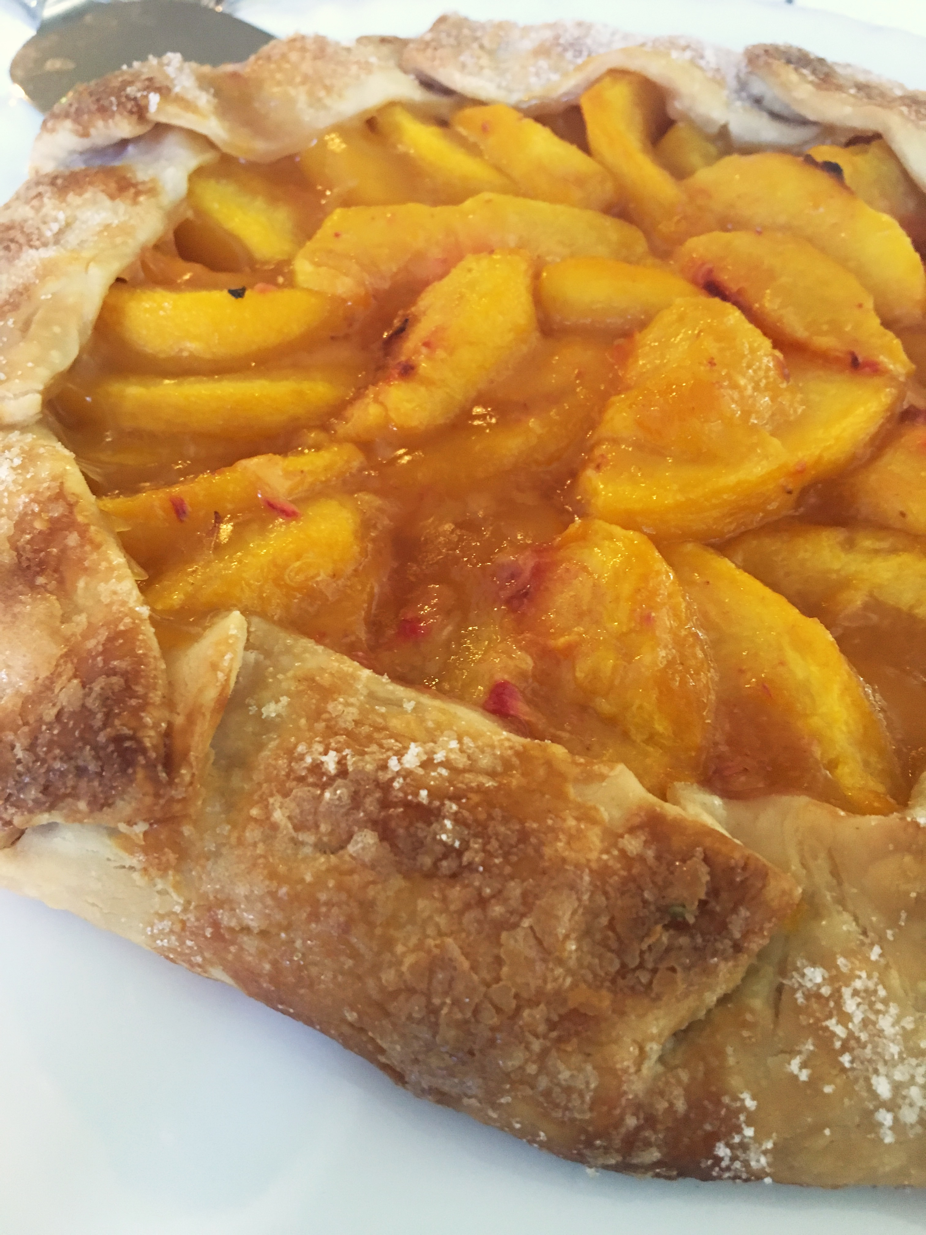 baked fresh peach galette fresh from the oven
