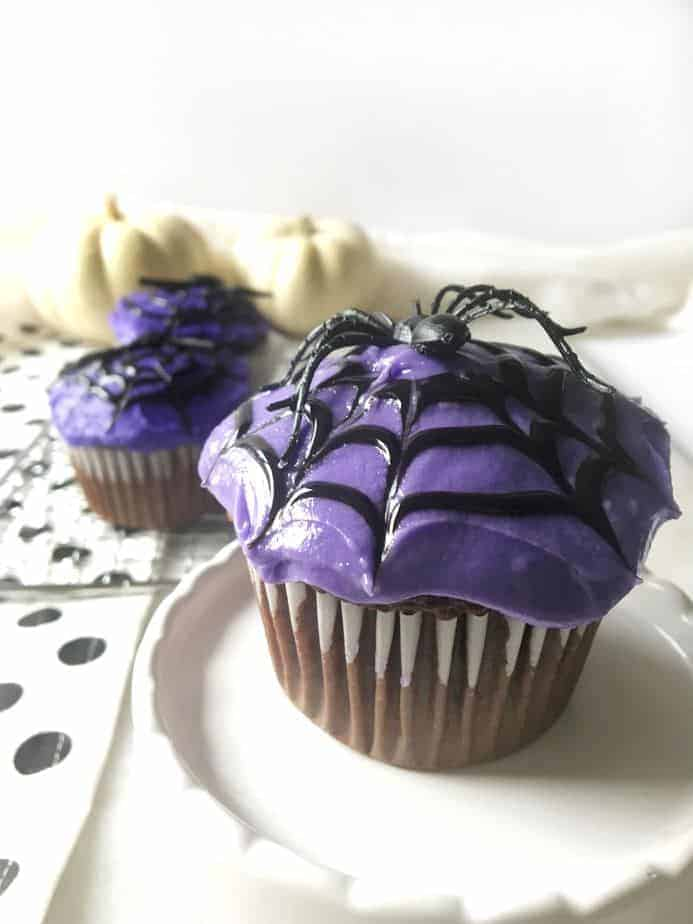 spider web cupcakes with purple frosting for Halloween