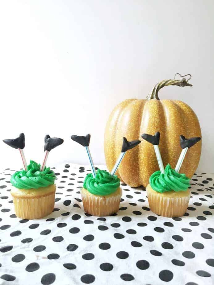 witches legs sticking up out of the ground on Hallowee cupcakes.