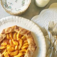 Peach Galette with serving plates and forks