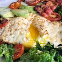 kale breakfast salad with runny yolk