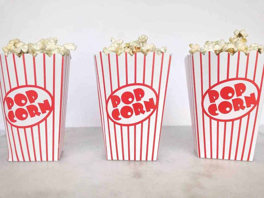 three popcorn buckets lined up in a row
