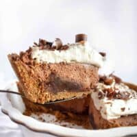 slice of chocolate pie being lifted out of dish