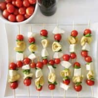 skewers with mozzarella, tortellini pasta, basil and tomatoes