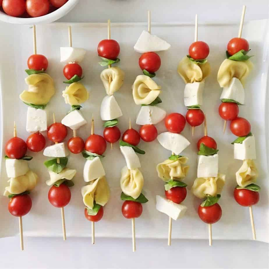 caprese skewers with mozzarella, tortellini, cherry tomatoes and basil