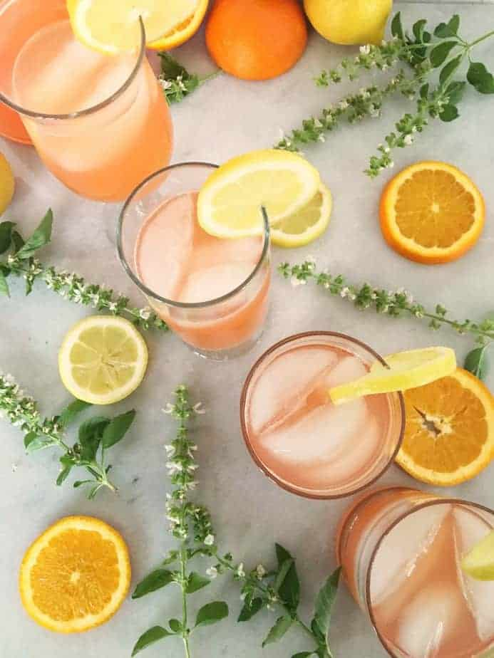 clear glasses full of pale orange party punch