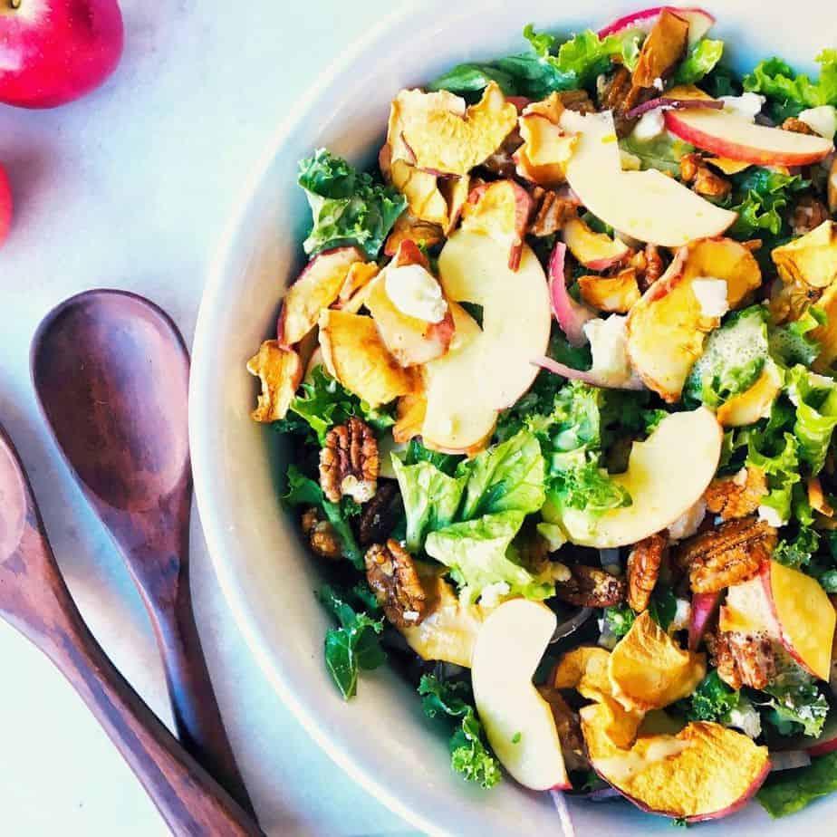 large white bowl filled with Fuji apple salad and Panera copycat Fuji apple salad dressing