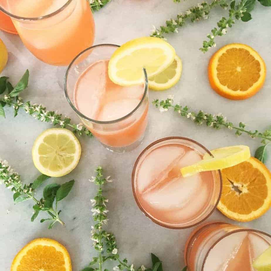 4 glasses filled with orange party punch. featured image.