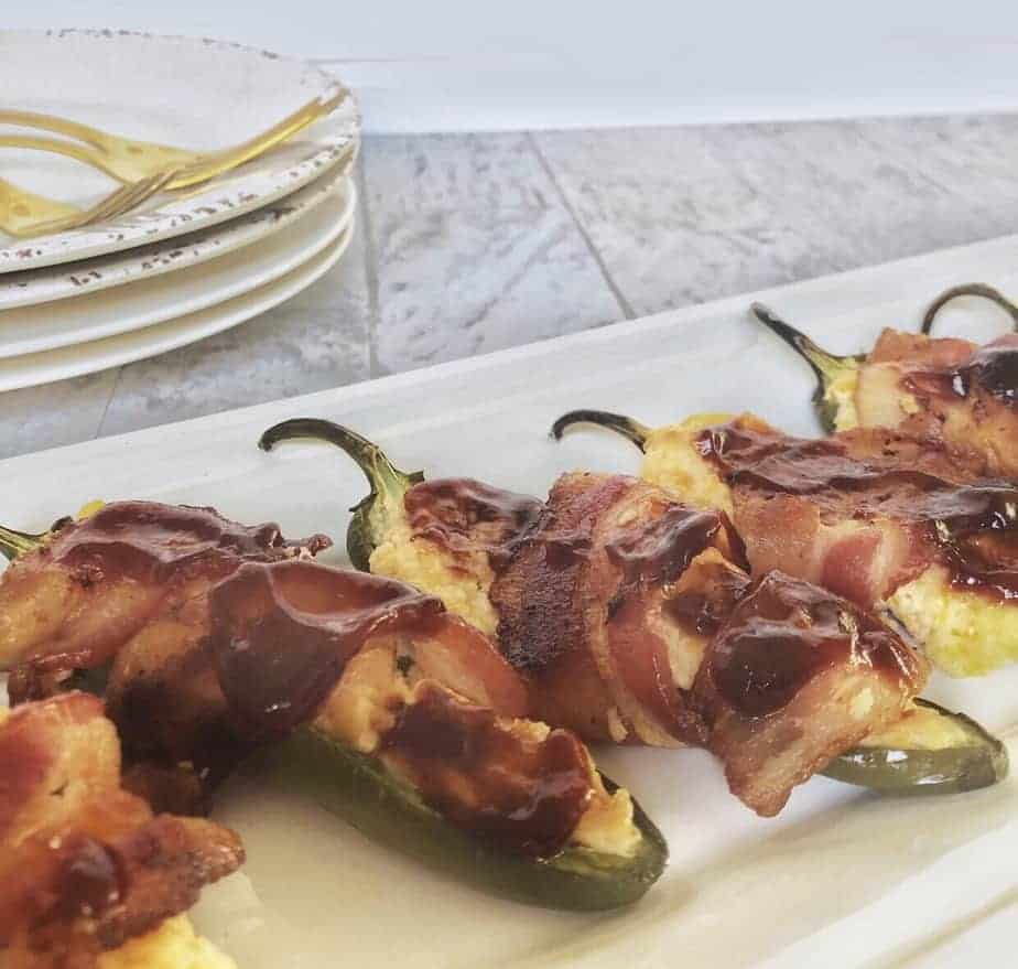 bacon wrapped jalapeno poppers on white tray