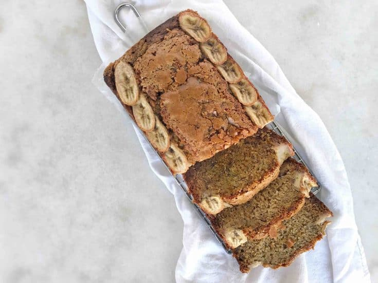 sliced banana bread loaf on white cloth