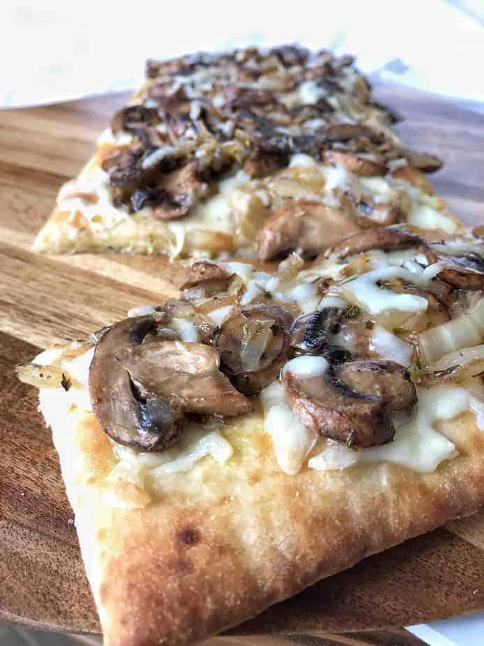 cheesy mushrooms and truffle oil on flatbread pizza