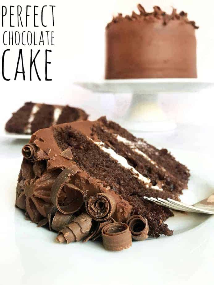 3 layer chocolate cake filled with whipping cream and topped with chocolate curls