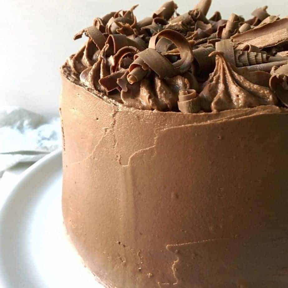 chocolate fudge frosting spread over chocolate layer cake