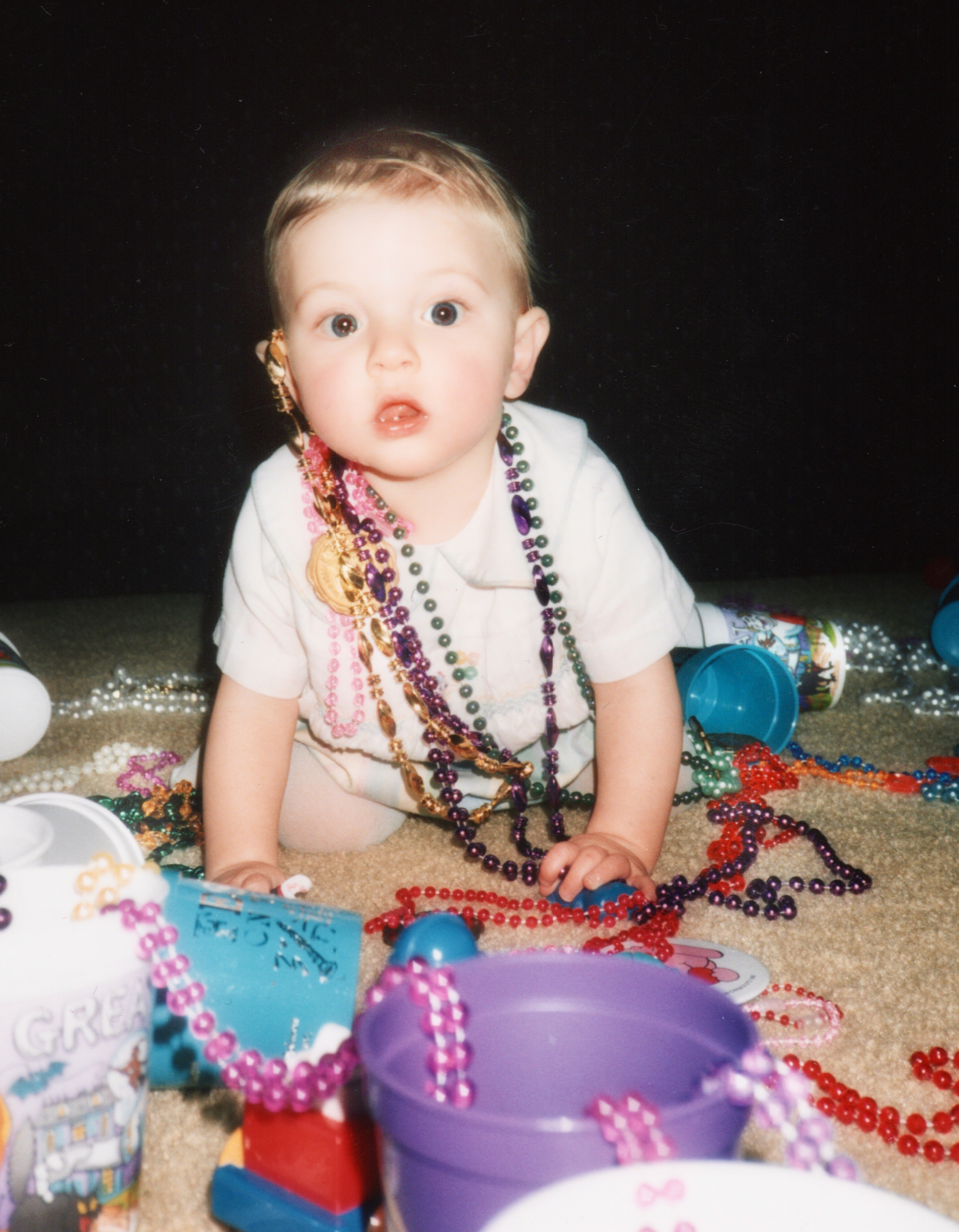baby covered in beads