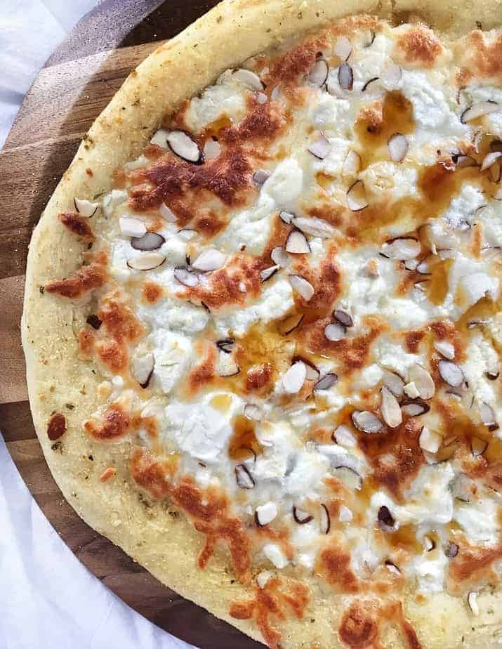 3 cheese pizza with honey and almonds close up