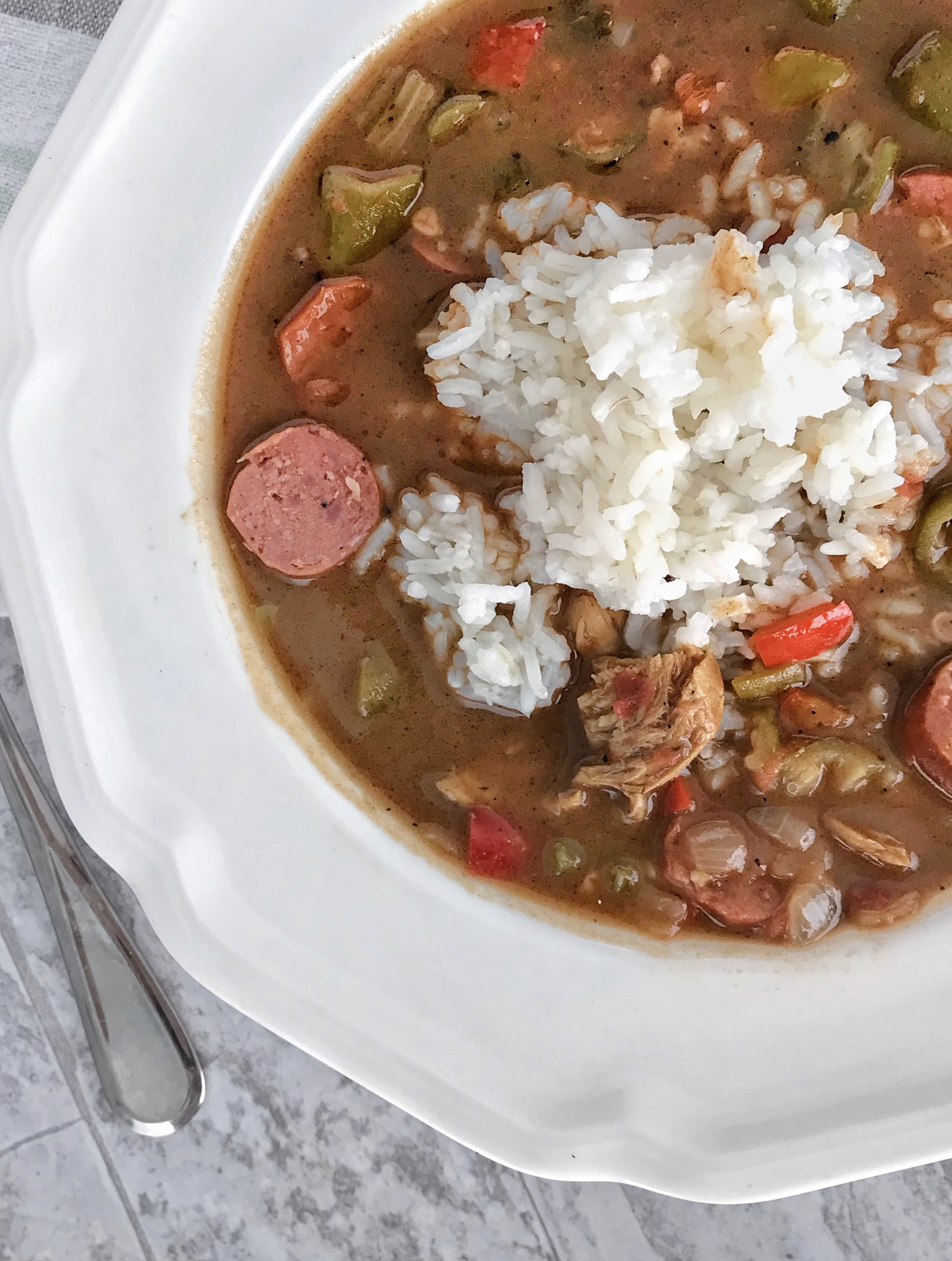 chicken and sausage gumbo with rice made with a dark roux