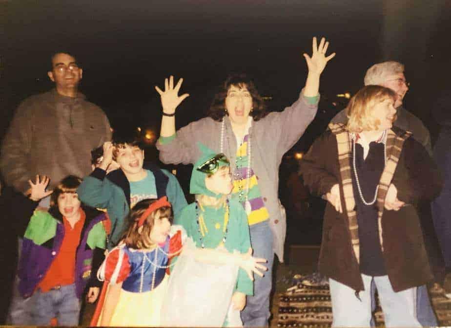 family watching Mardi Gras parade