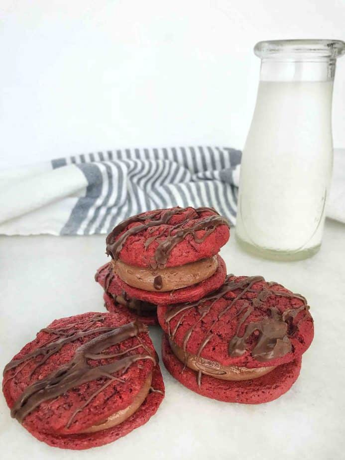 4 red velvet cookie sandwiches with bottle of milk