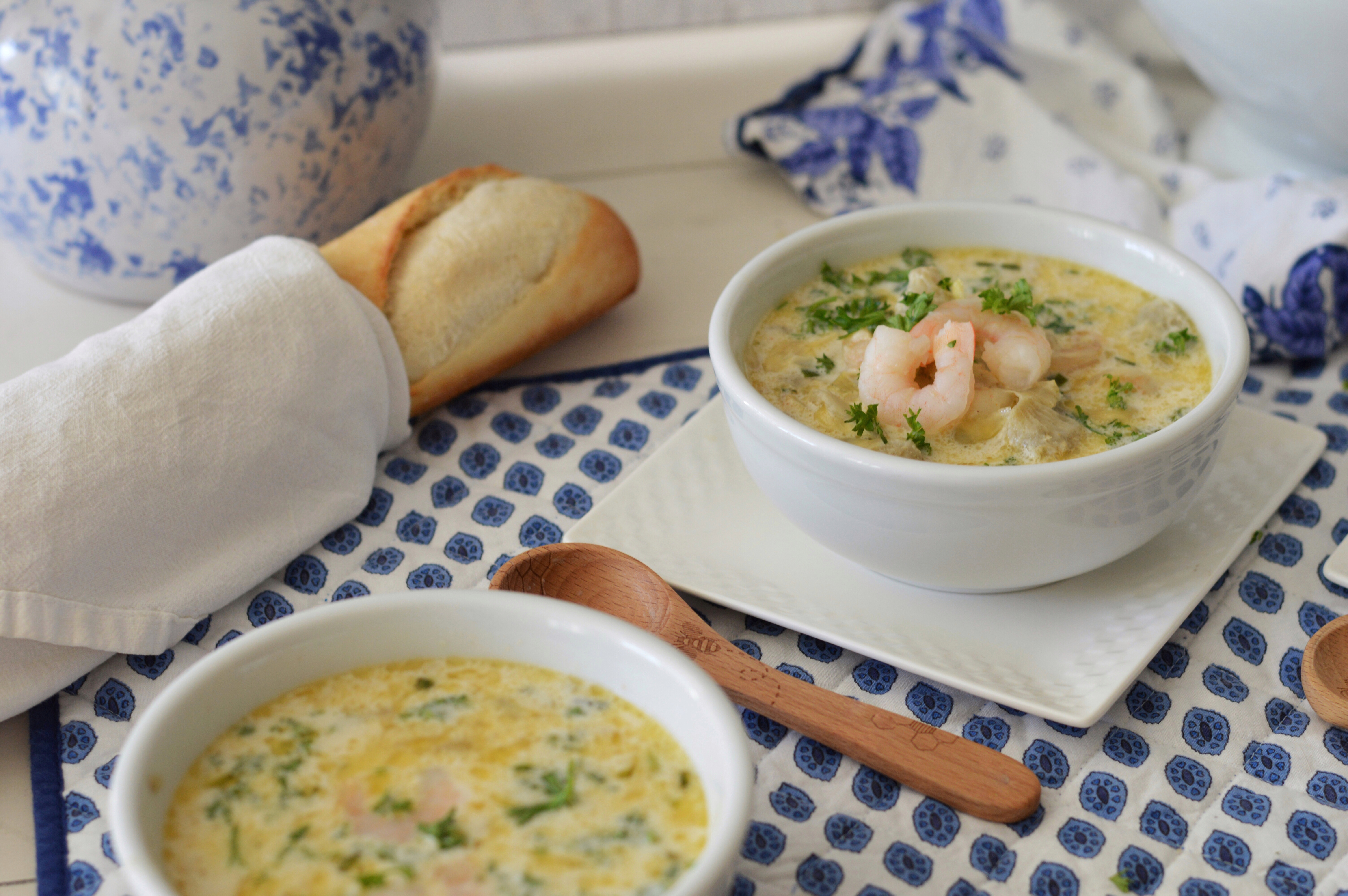 shrimp and artichoke bisque with loaf of French bread