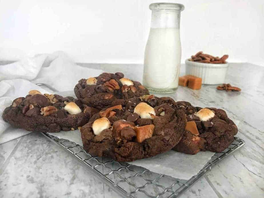 rocky road cookies on cooling rack with milk bottle