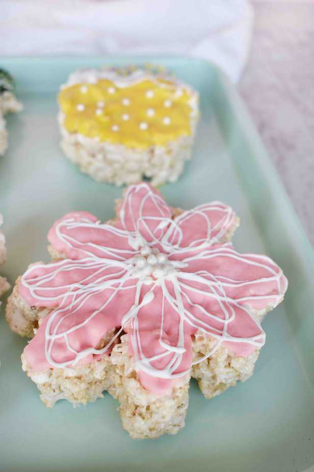 pink flower rice krispie treat on blue tray
