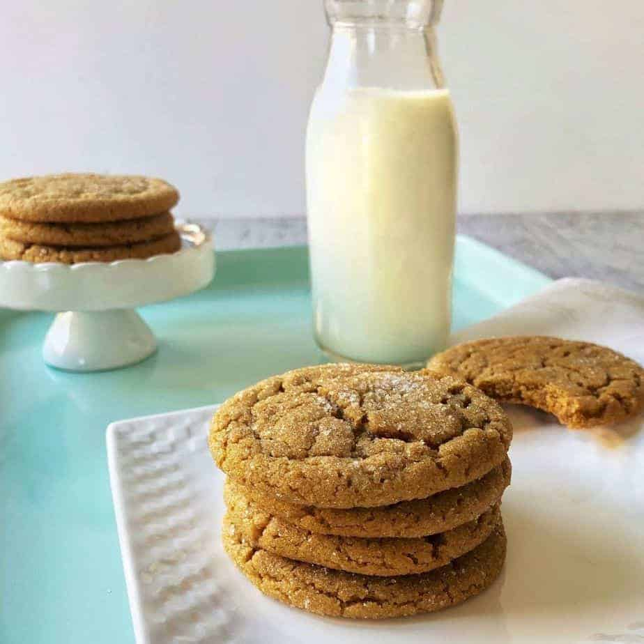 stack of ginger cookies and bottle of milk. featured image