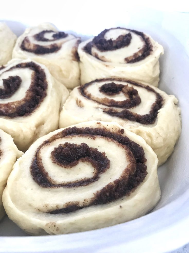banana cinnamon rolls sliced and in a pan before baking
