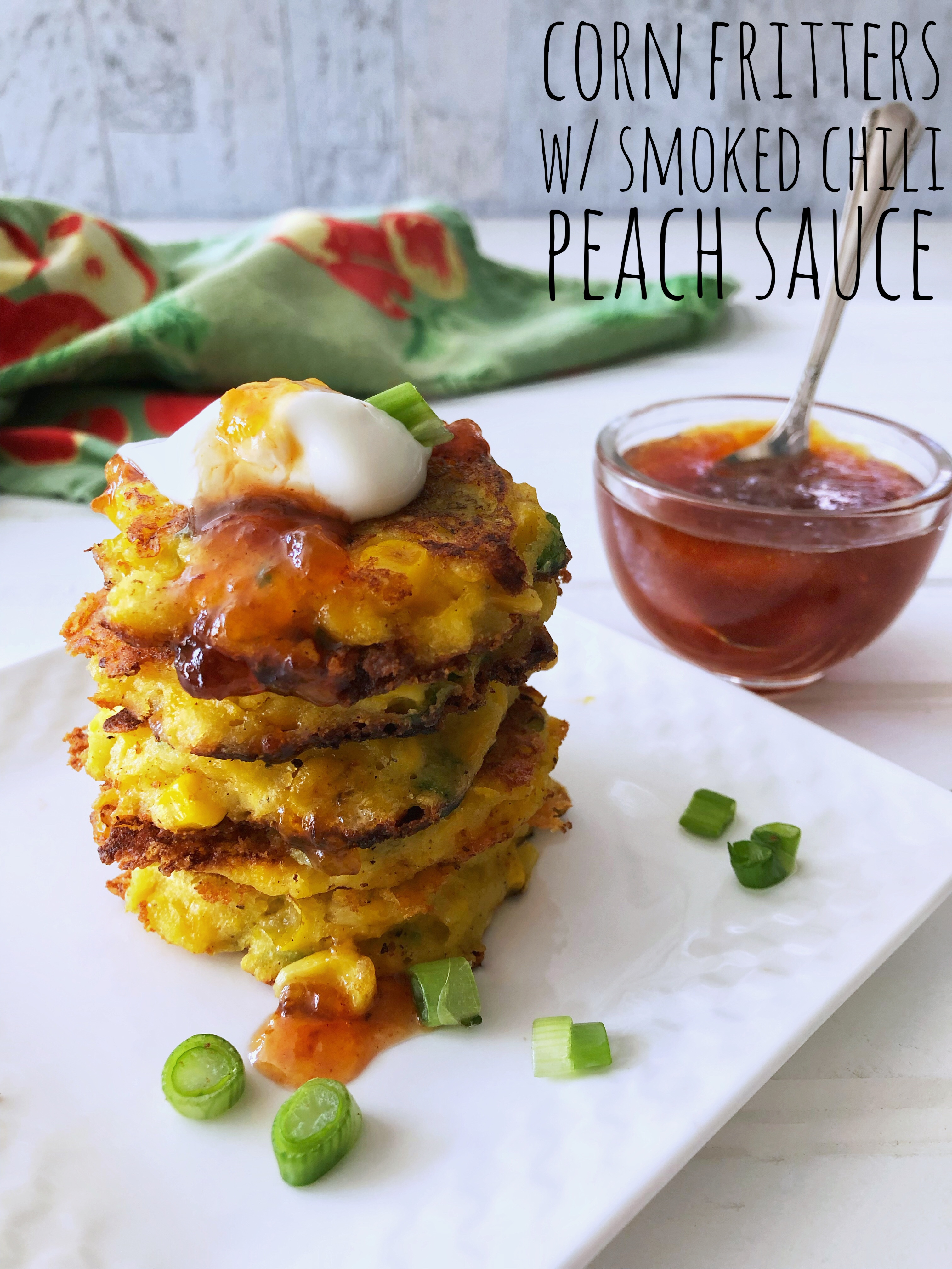 stack of corn fritters with smoked chili peach sauce