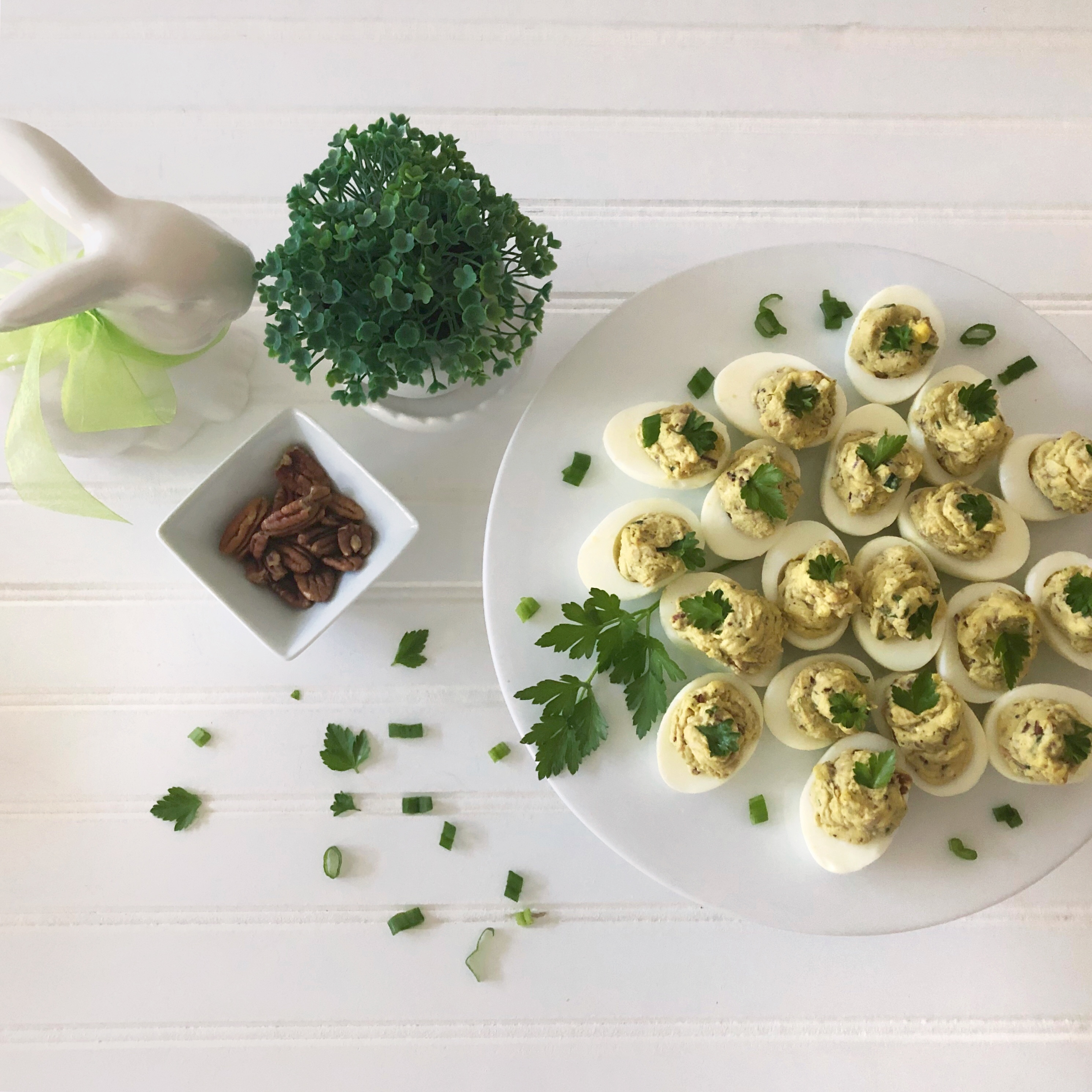 deviled eggs on platter with with pecans and bacon, and bunny