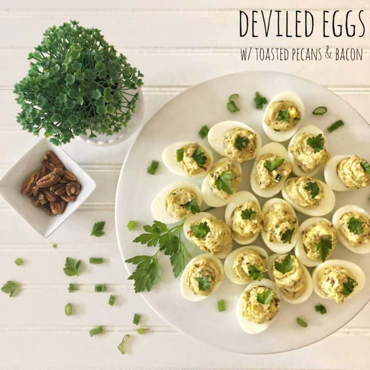 platter of deviled eggs with pecans and bacon