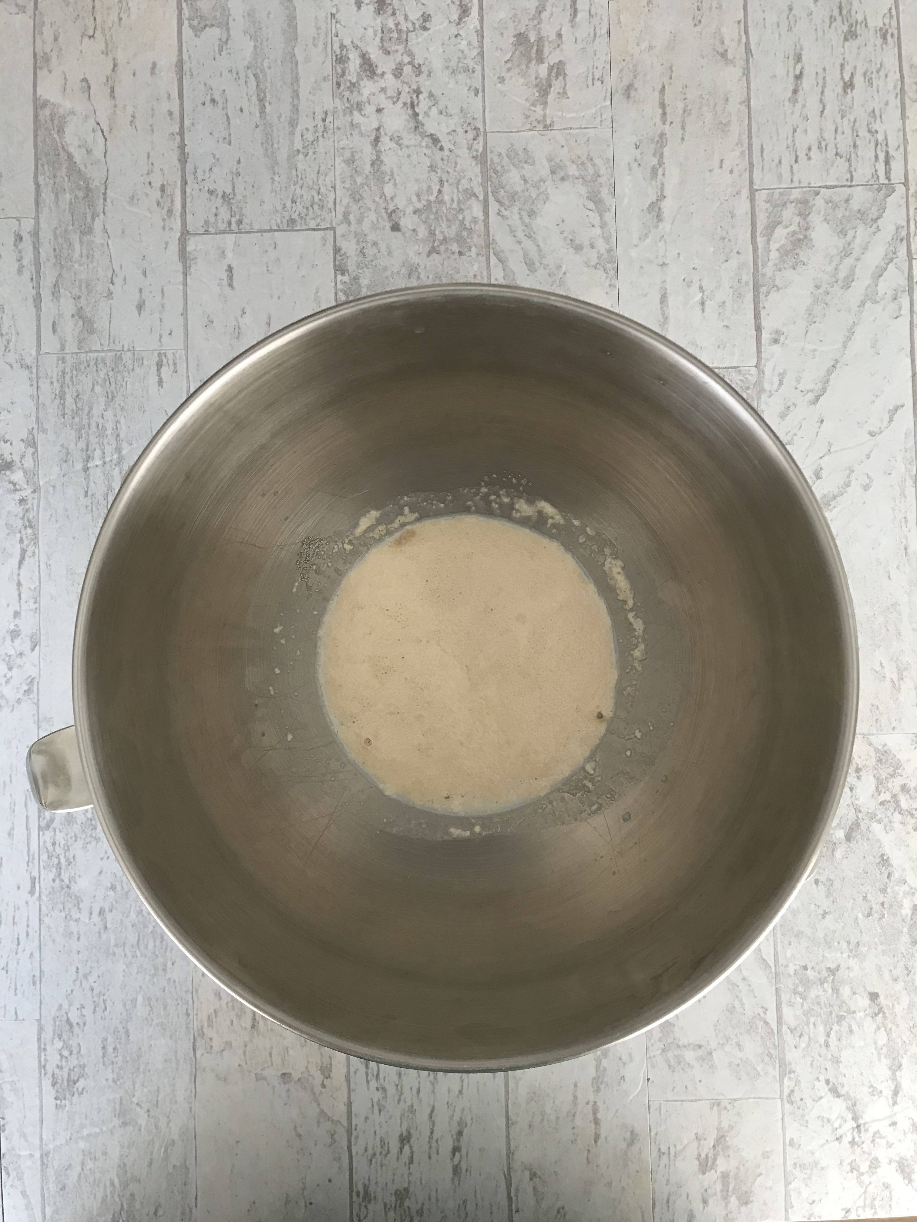 bloomed yeast, milk, and sugar in a bowl