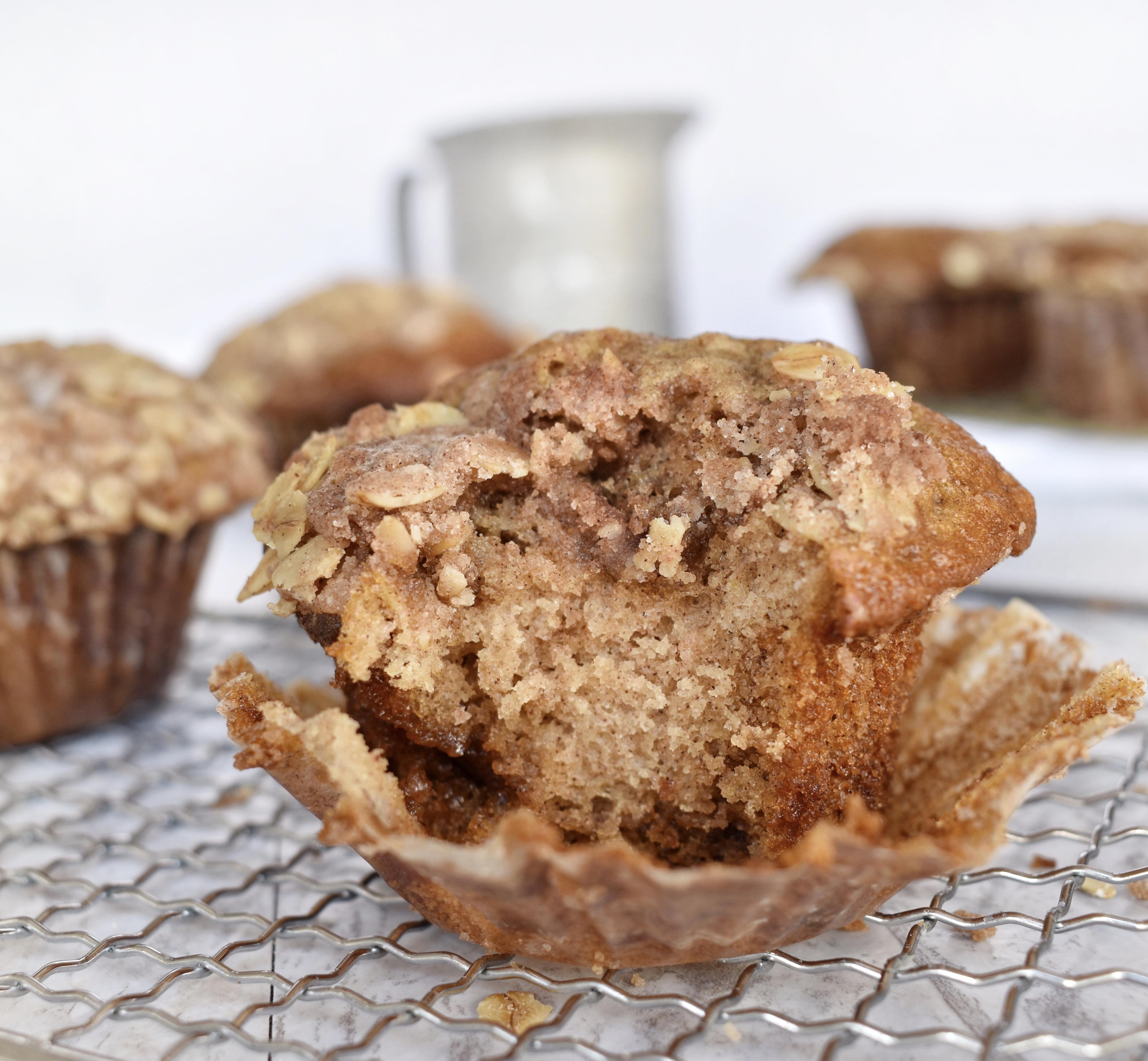 cinnamon streusel muffin with bite out of it on cooling rack