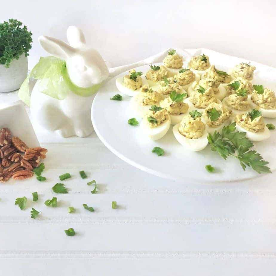 white bunny and white platter with deviled eggs. featured image