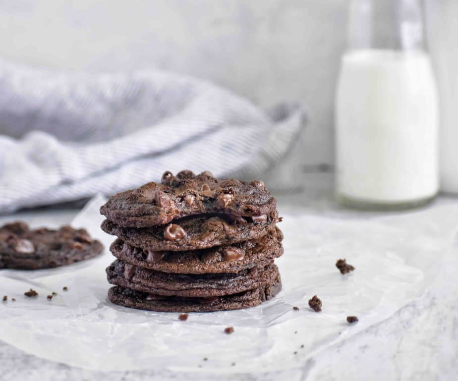 stack of chocolate cookies with bite out of cookie