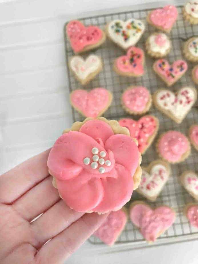 flower sugar cookie in hand
