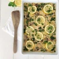 Lemon Chicken, Artichoke Hearts and Mushrooms in white pan