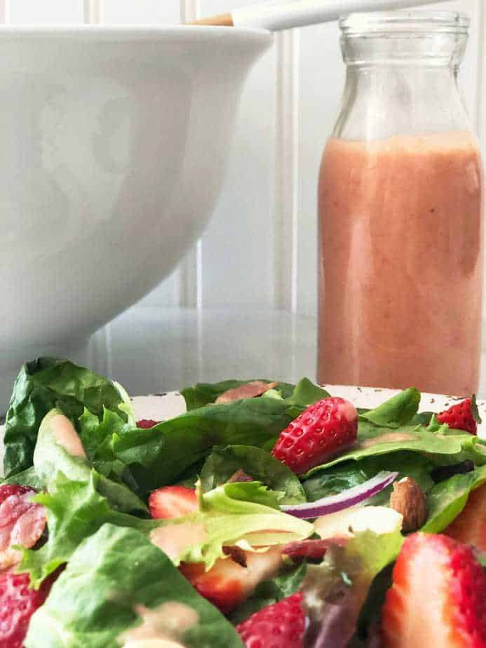 bowl of strawberry spinach salad and strawberry dressing