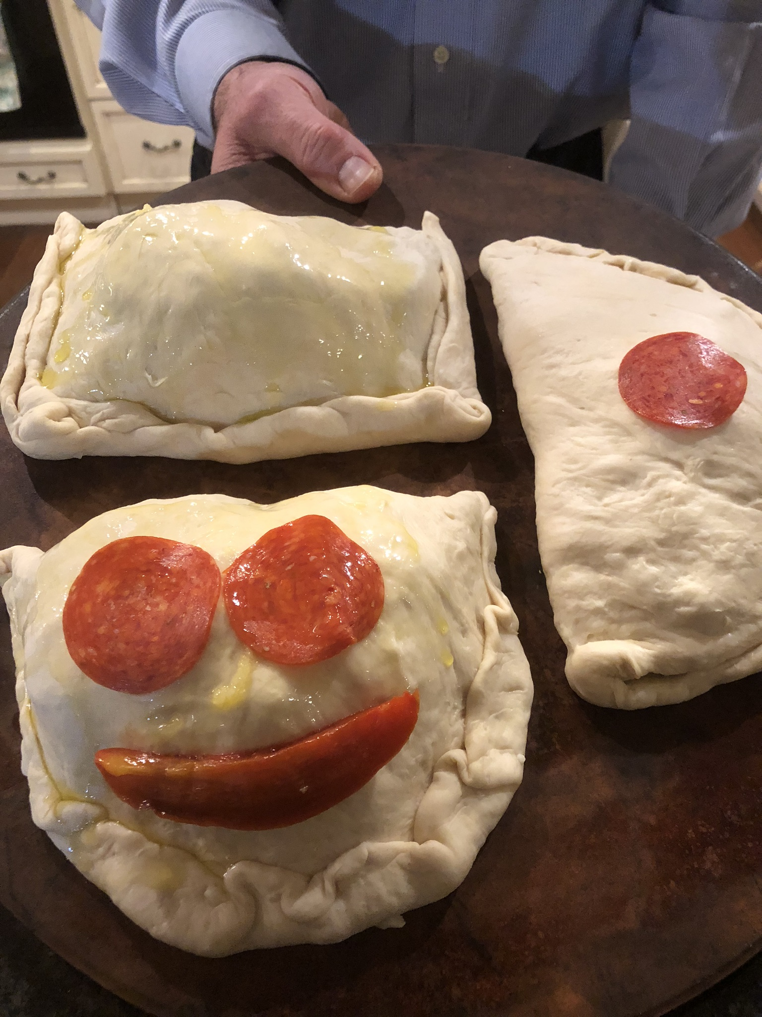 Homemade calzone stuffed with Mozzarella and other fillings