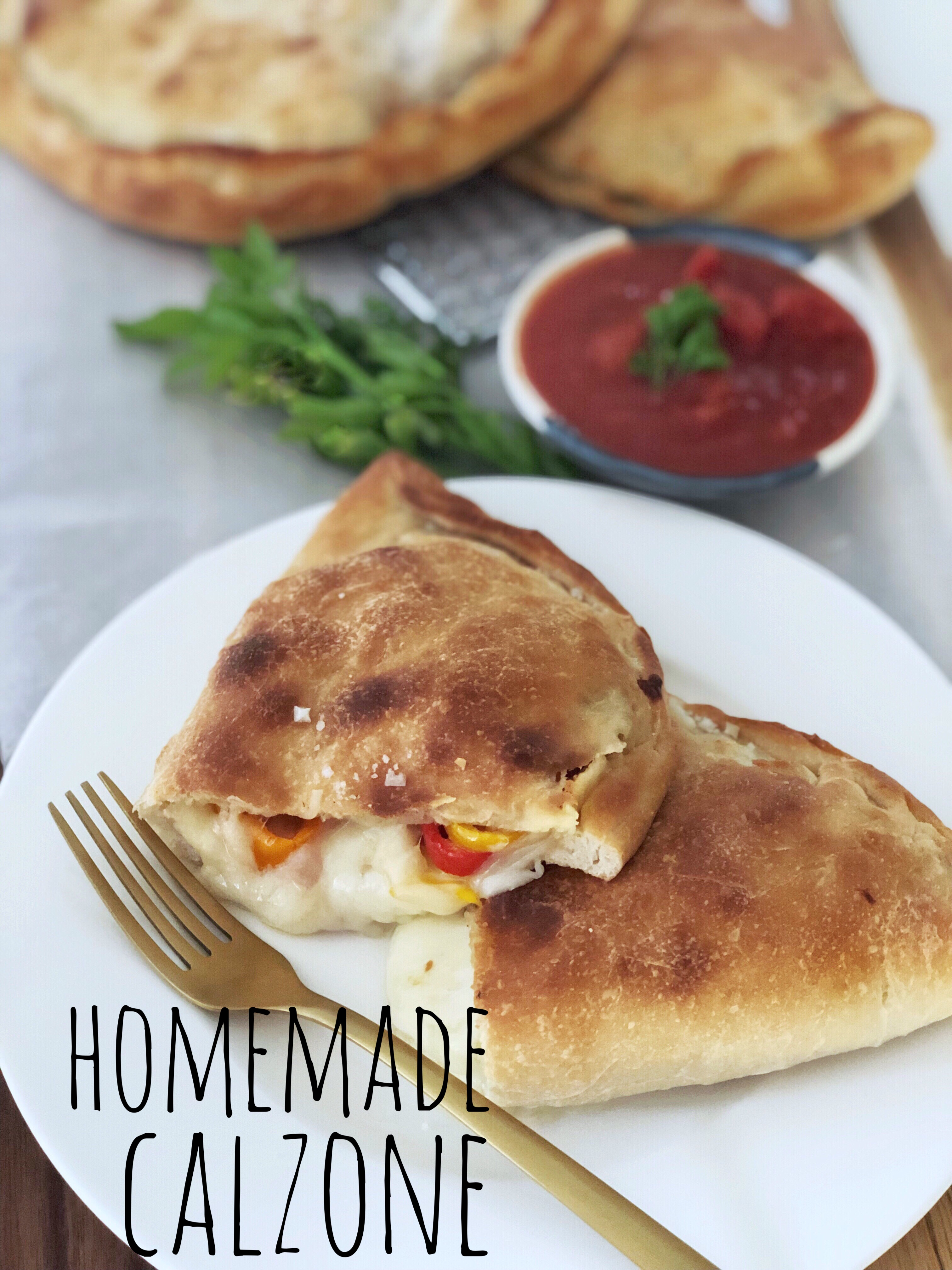 Homemade Calzone stuffed with Mozzarella, meat and vegetables